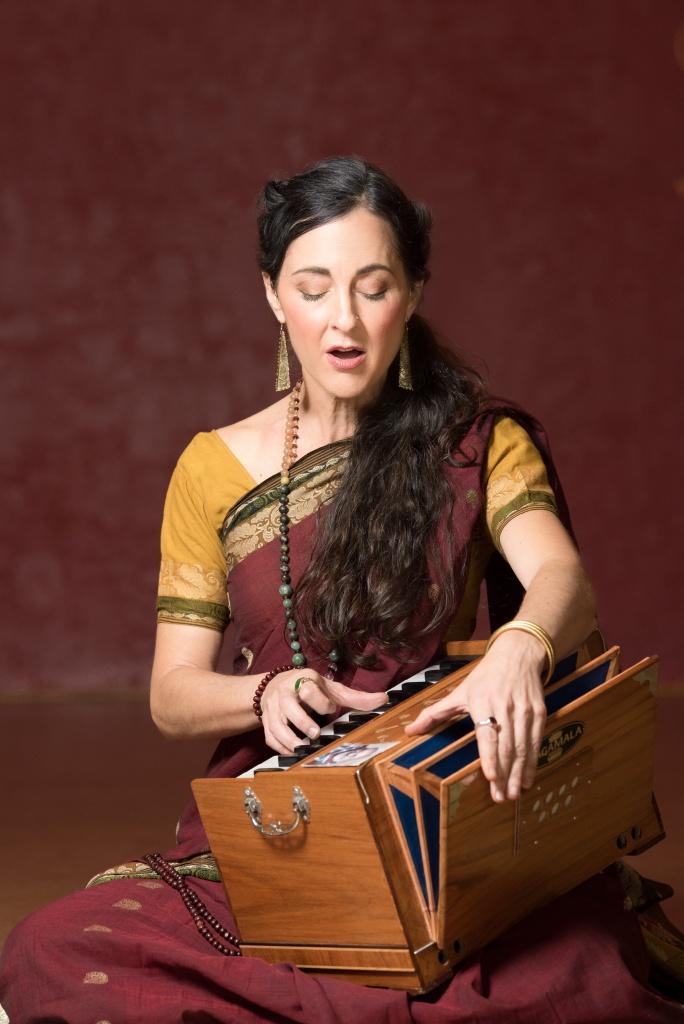 kavita macmillan playing harmonium.